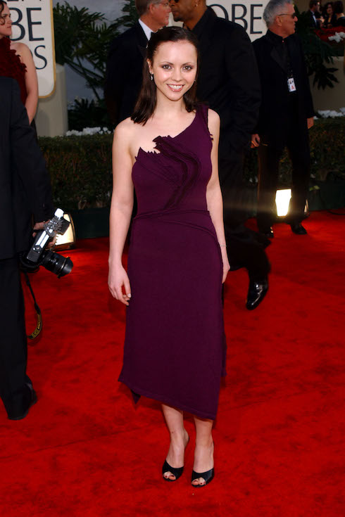 Christina Ricci wears a purple, one-shoulder gown to the 2002 Golden Globe Awards