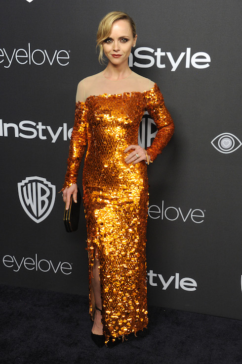 Christina Ricci wears an off-the-shoulder metallic gold gown to a Golden Globes party in 2017