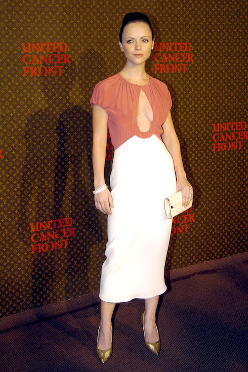 Christina Ricci wears a pink and white dress to an even hosted by Louis Vuitton in 2004