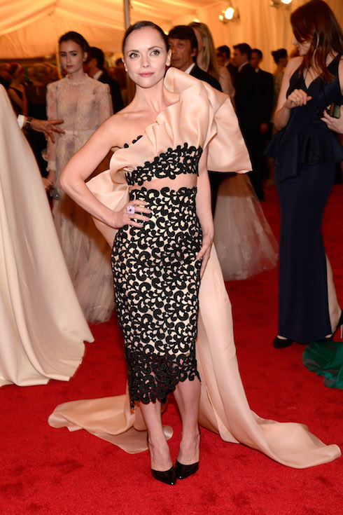 Christina Ricci wears a blush-and-black gown to the 2012 MET Gala
