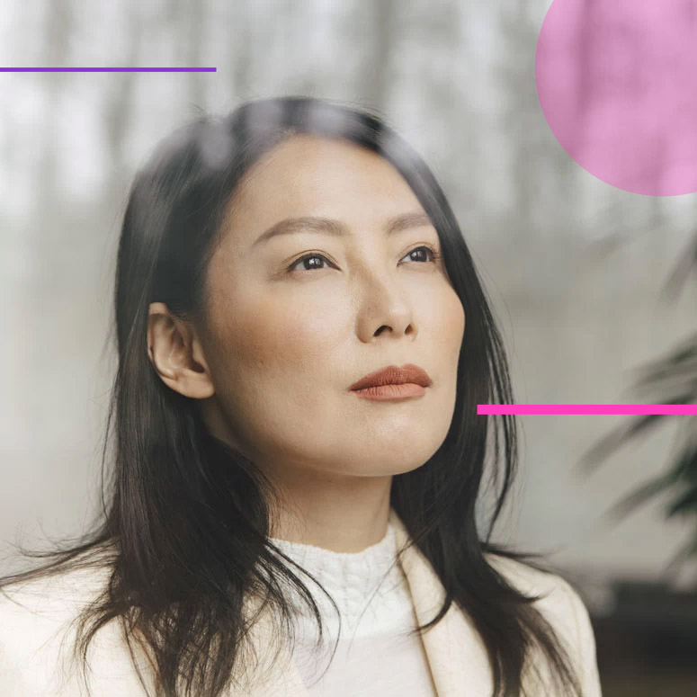 Asian woman pensive as she looks up and forward
