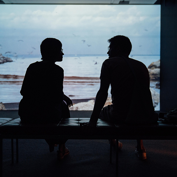 Silhouette of couple having a talk