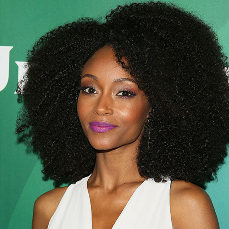 Model and actor Yaya DaCosta smiling at the camera