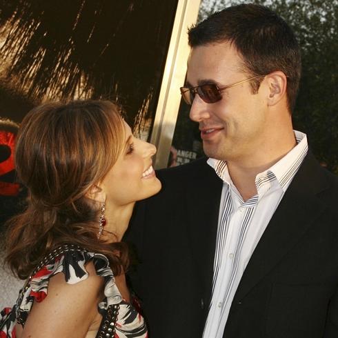 Sarah Michelle Gellar looks up happily at her husband Freddie Prinze Jr.