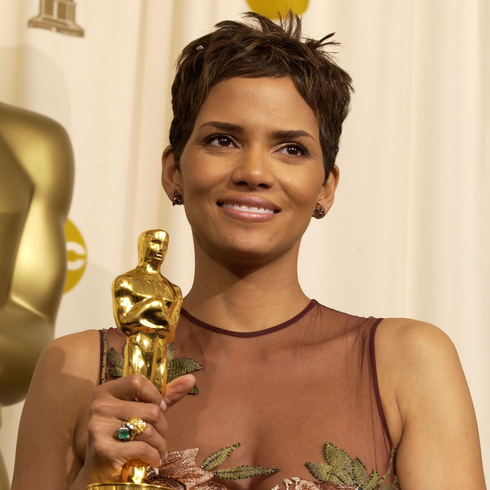 Halle Berry holding her Oscar for Best Actress