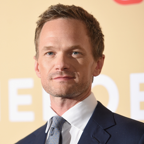 Neil Patrick Harris poses on a red carpet with confidence