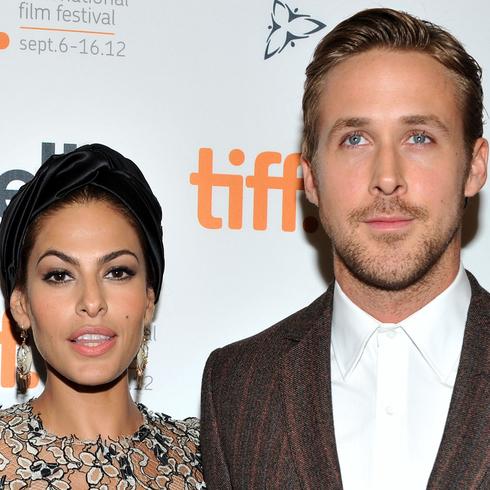 Ryan Gosling and Eva Mendes pose together at TIFF