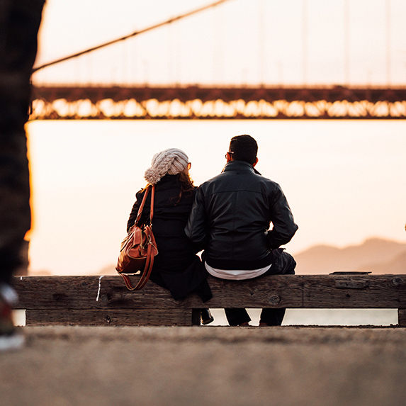 Couple by the bay talking