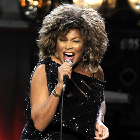 Tins Turner singing on stage