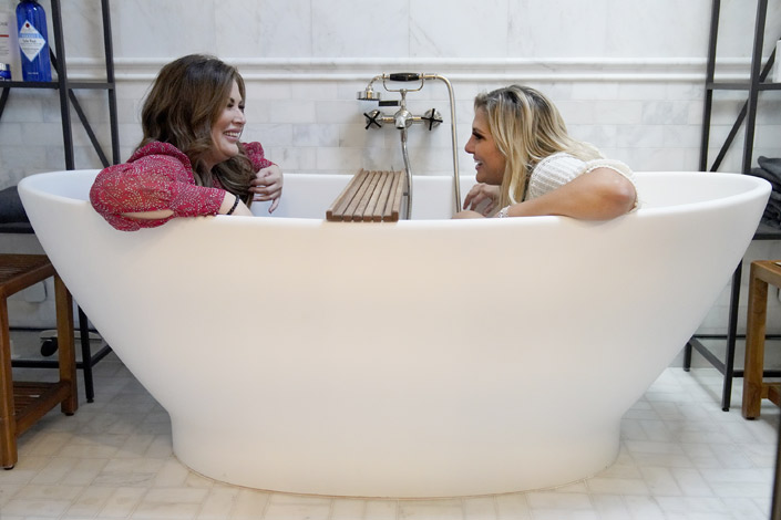 Emily Simpson laughs with Gina in a bathtub