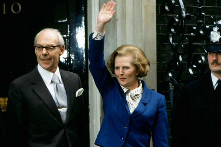 Margaret Thatcher waves to the crowd outside Downing Street with her husband in 1979