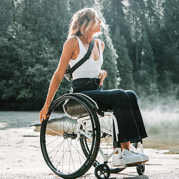 Woman in wheelchair in nature taking it all in